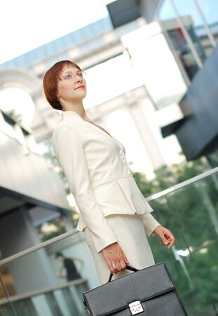 business woman with black briefcase walking street photo