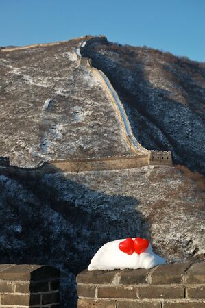 two red balloon in the form of a heart on Great wall in snow Stock Photo - 6182327