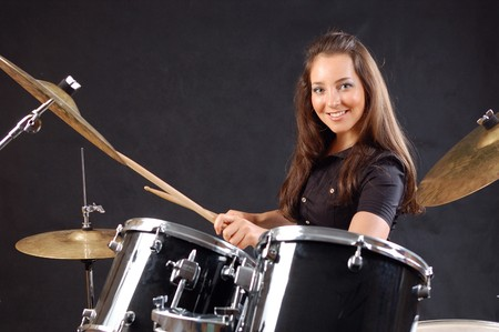 drummer: Beautiful student on the drums lesson.