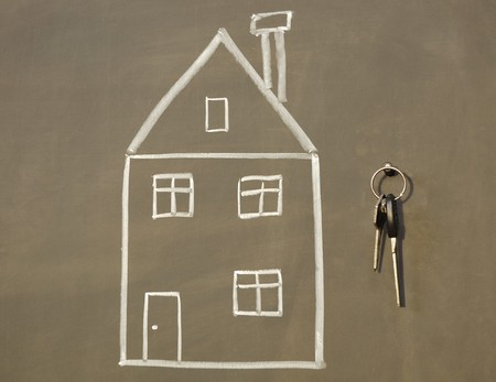 sketch of house and real keys on the blackboard photo