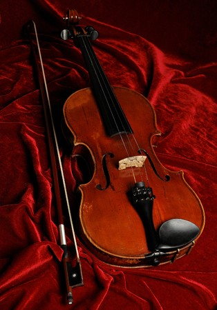 old-fashioned violine on the purple velvet background photo