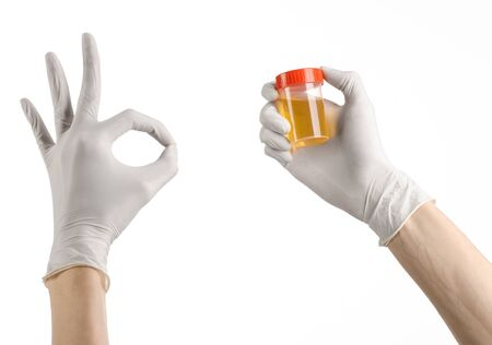 urea: Medical theme: doctors hand in white gloves holding a transpare Stock Photo