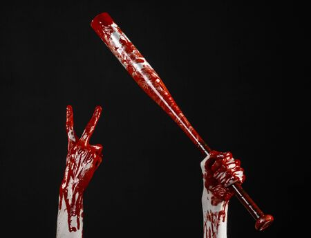 diabolic: bloody hand holding a baseball bat, a bloody baseball bat, bat, blood sport, killer, zombies, halloween theme, isolated, black background studio Stock Photo
