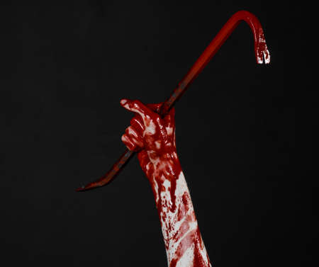 diabolic: Bloody hands with a crowbar, hand hook, halloween theme, killer zombies, black background, isolated, bloody crowbar studio