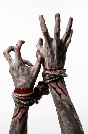 demonic: Hands bound,bloody hands, mud, rope, on a white background, isolated, kidnapping, zombie, demon studio