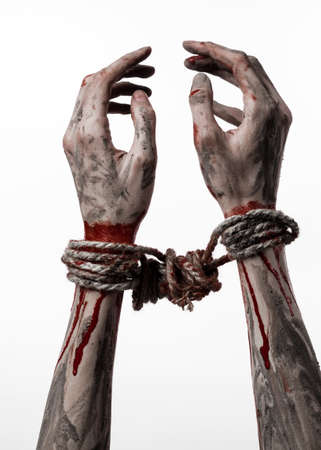 kidnapping: Hands bound,bloody hands, mud, rope, on a white background, isolated, kidnapping, zombie, demon studio