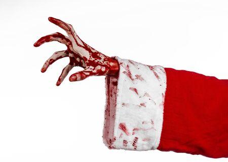 diabolic: Christmas and Halloween theme: Santa Zombie bloody hand on a white background studio Stock Photo