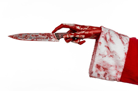 diabolic: Christmas and Halloween theme: Santas bloody hands of a madman holding a bloody knife on an isolated white background studio
