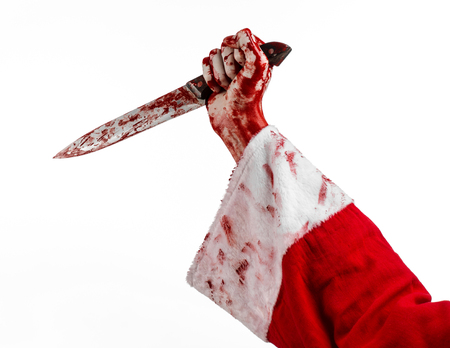 Christmas and Halloween theme: Santa's bloody hands of a madman holding a bloody knife on an isolated white background studio Standard-Bild