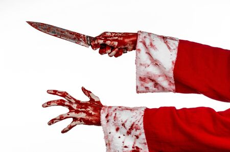 madman: Christmas and Halloween theme: Santas bloody hands of a madman holding a bloody knife on an isolated white background studio