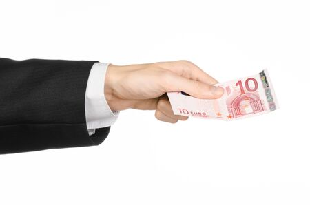 10 fingers: Money and business topic: hand in a black suit holding a banknote 10 euro isolated on a white background
