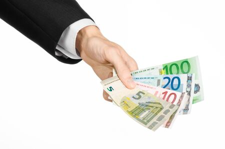 5 to 10: Money and business topic: hand in a black suit holding banknotes 5,10,20 and 100 euro on white isolated background