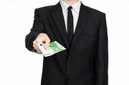 banknote: Money and business theme: a man in a black suit holding a banknote 100 euro isolated on a white background Stock Photo
