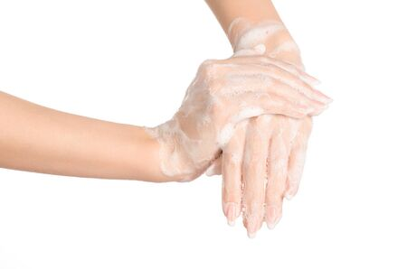 sudsy: Hygiene and health protection topic: a womans hand in soapsuds isolated on white background