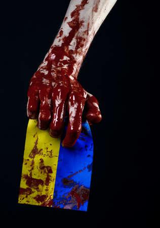 diabolic: Bloody hands, the flag of Ukraine in the blood, revolution in Ukraine, Black background