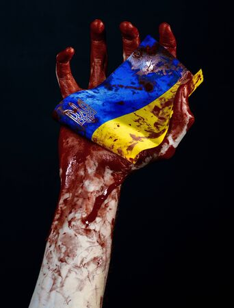 separatism: Bloody hands, the flag of Ukraine in the blood, revolution in Ukraine, Black background