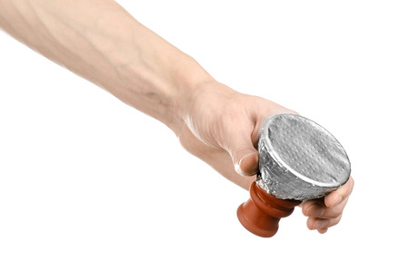 glycerol: Bartender holding a clay bowl with tobacco for hookah covered with a foil with holes isolated on a white background