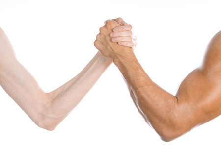 wrestling: Bodybuilding & Fitness Topic: arm wrestling thin hand and a big strong arm isolated on white background Stock Photo