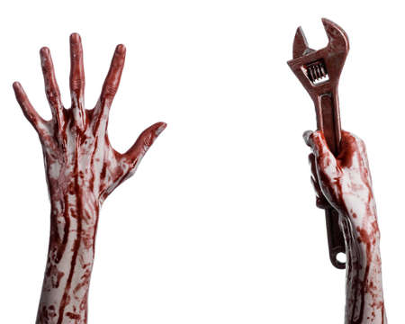 hand tool: Halloween theme: bloody hand holding a big wrench on a white background studio