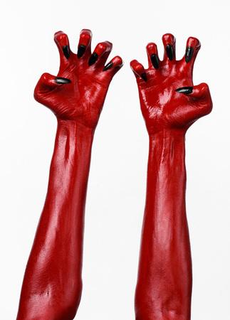 satan: las manos del diablo rojo, rojo las manos de Satanás, tema de Halloween, fondo blanco, aislado Foto de archivo