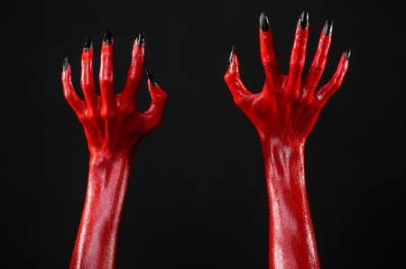 satan: Red Devils hands, red hands of Satan, Halloween theme, black background, isolated studio Lizenzfreie Bilder