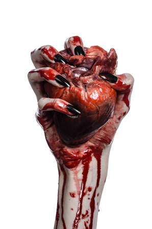 walking corpse: Bloody horror and Halloween theme: Terrible bloody hands with black nails holding a bloody human heart on a white background isolated background