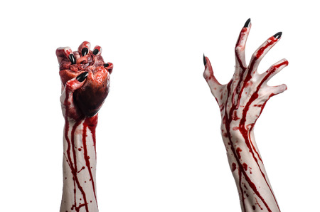 carnage: Bloody horror and Halloween theme: Terrible bloody hands with black nails holding a bloody human heart on a white background isolated background