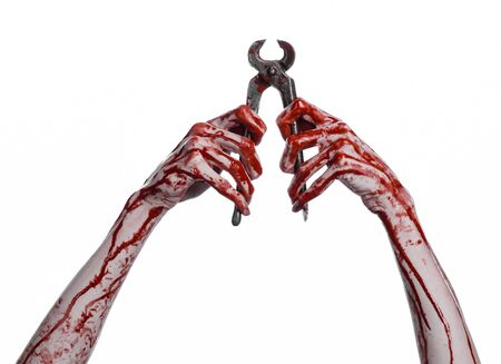 carnage: Halloween theme: bloody hand holding a pliers on a white background studio Stock Photo