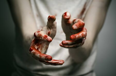 experiencing: Bloody theme lone murderer: the murderer shows bloody hands and experiencing depression and pain studio Stock Photo
