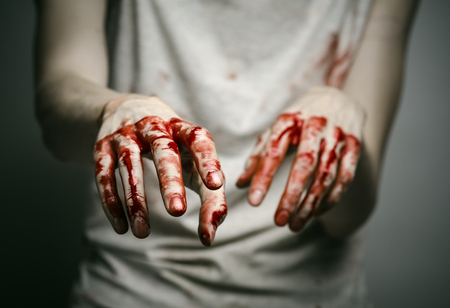 murderer: Bloody theme lone murderer: the murderer shows bloody hands and experiencing depression and pain studio Stock Photo