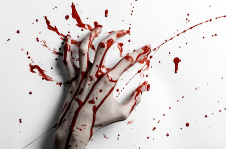 bloody hand print: Bloody halloween theme: bloody hand print on a white leaves bloody wall studio Stock Photo
