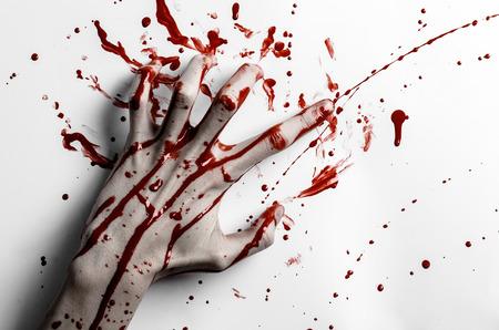 Bloody halloween theme: bloody hand print on a white leaves bloody wall studio Standard-Bild