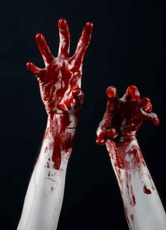 diabolic: Bloody halloween theme: bloody hands killer zombie isolated on black background in studio