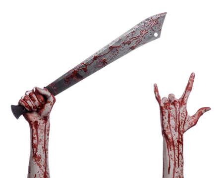 machete: Halloween theme: hand holding a bloody machete on a white background Stock Photo
