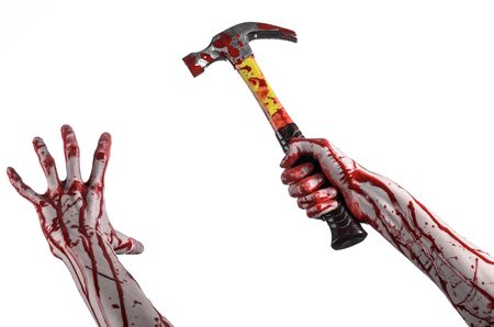 walking corpse: Bloody halloween theme: bloody hand holding a bloody hammer isolated on a white background