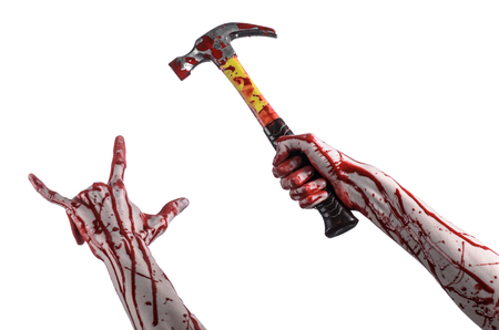 carnage: Bloody halloween theme: bloody hand holding a bloody hammer isolated on a white background