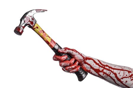 tool and die: Bloody halloween theme: bloody hand holding a bloody hammer isolated on a white background