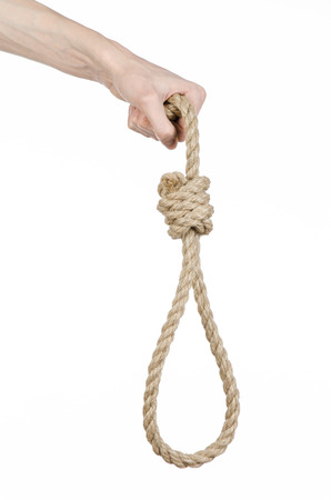 strangle: Lynching and suicide theme: mans hand holding a loop of rope for hanging on white isolated background