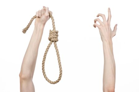 choke: Lynching theme: mans hand holding a loop of rope for hanging on white isolated background Stock Photo
