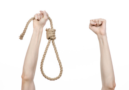 capital punishment: Lynching theme: mans hand holding a loop of rope for hanging on white isolated background Stock Photo