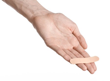 cut wrist: Medical theme: for a mans hand glued medical plaster first aid plaster advertising on a white background Stock Photo