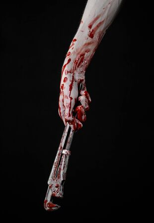 assassin: bloody hand holding an adjustable wrench, bloody key, crazy plumber, bloody theme, halloween theme, black background,isolated , bloody hand of an assassin, bloody murderer, psycho, bloody monkey wrench Stock Photo