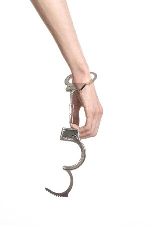 manacle: Prison and convicted topic: man hands with handcuffs isolated on white background in studio, put handcuffs on killer studio Stock Photo