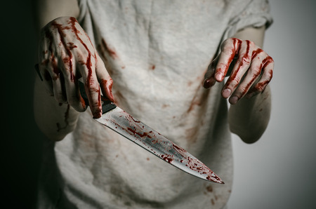 carnage: Blood and Halloween theme: man holding a bloody knife in his hand, a bloody murderer studio