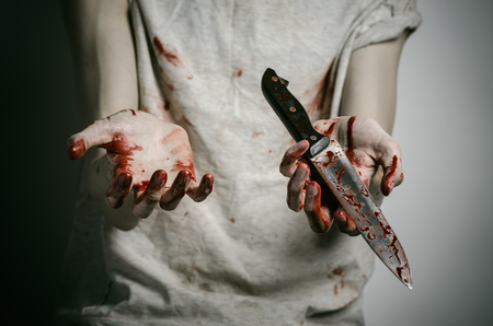 murderer: Blood and Halloween theme: man holding a bloody knife in his hand, a bloody murderer studio