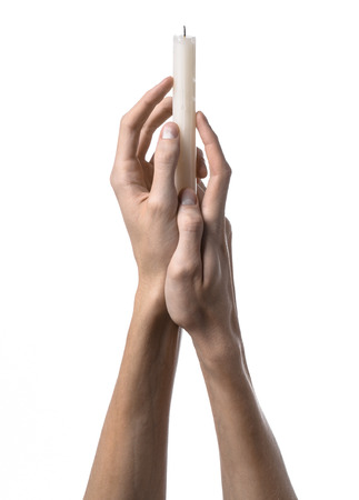 death candle: hands holding a candle, a candle is lit, white background, solitude, warmth, in the dark, Hands death, hands witch