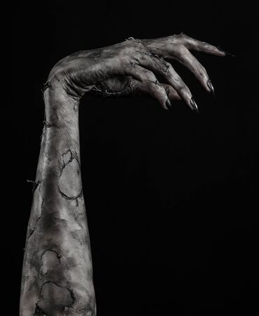 walking corpse: black hand of death, the walking dead, zombie theme, halloween theme, zombie hands, black background, isolated, hand of death, mummy hands, the hands of the devil, black nails, hands monster Stock Photo
