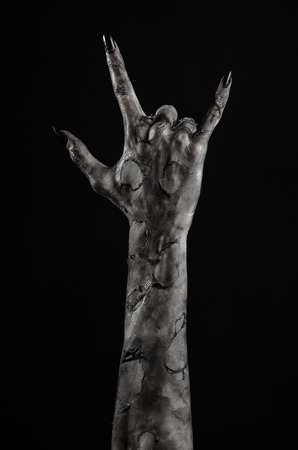 black hand of death, the walking dead, zombie theme, halloween theme, zombie hands, black background, isolated, hand of death, mummy hands, the hands of the devil, black nails, hands monster Standard-Bild