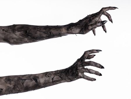 black hand of death, the walking dead, zombie theme, halloween theme, zombie hands, white background, isolated, hand of death, mummy hands, the hands of the devil, black nails, hands monster Stockfoto