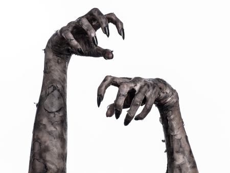 black hand of death, the walking dead, zombie theme, halloween theme, zombie hands, white background, isolated, hand of death, mummy hands, the hands of the devil, black nails, hands monster Foto de archivo